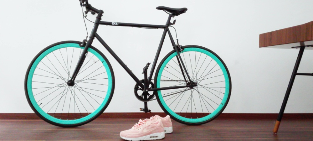 Green bike with pink trainers